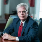 Corporate, estate planning, litigation, and real estate attorney B. E. Brannock in his office