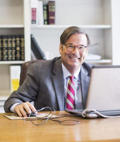 Medical malpractice and health care attorney James Mayson behind a computer in his office