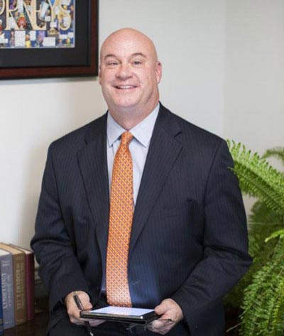 Litigation, business, construction, government, and insurance attorney Randall Perdue in his office