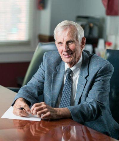 Retired attorney John Sills in an office.