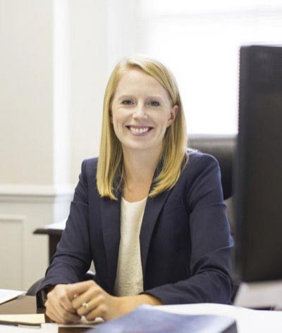 Litigation, health care, and product liability attorney Noelle Quam behind her desk